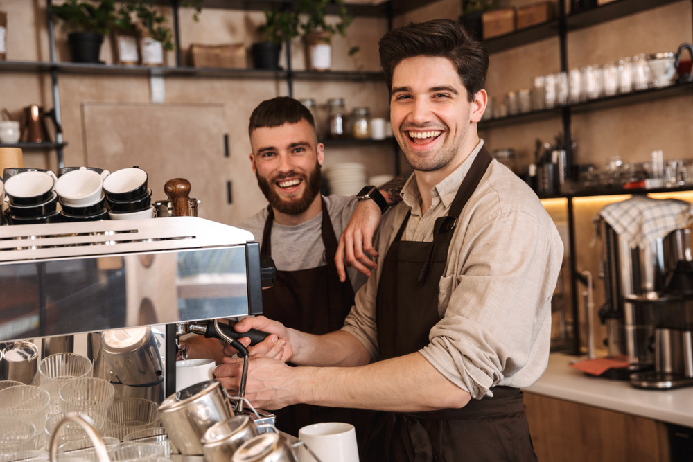 Group,Of,Cheerful,Men,Baristas,Wearing,Aprons,Working,At,The